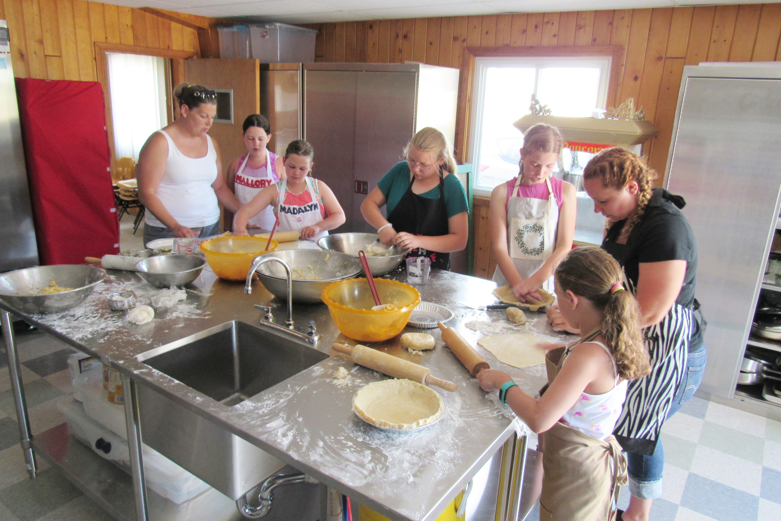 Orleans County 4-Hers and volunteers work recently at a Pie Workshop in the newly renovated Trolley Building on the fairgrounds. The pies will be sold at the Leader's Pie Stand during the upcoming Orleans County 4-H Fair to raise funds for 4-H activities and award trips. K. Gabalski photo