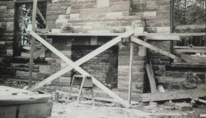 A slide of a photograph in Jennifer Wells-Dickerson's collection.  It shows construction of a fireplace in one of the shelters at Hamlin Beach State Park.  The shelter and fireplace were constructed of Medina sandstone from the Clarendon quarry owned by her great-grandfather, Pasquale DiLaura. DiLaura worked as the initial mason foreman on the Hamlin Beach project, teaching Civilian Conservation Corps crews how to cut the Medina sandstone.