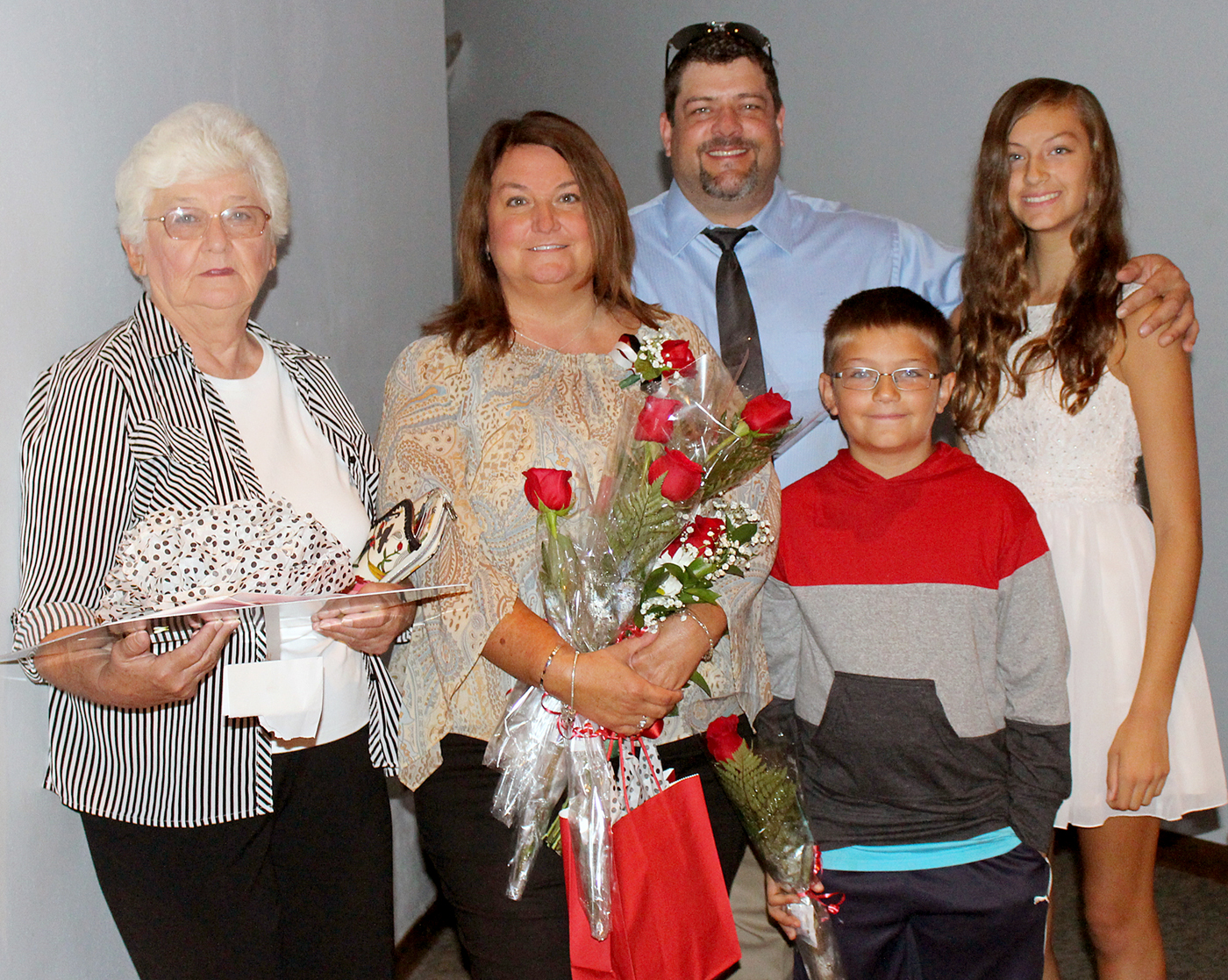 Stephanie Harney, Hilton CSD Teacher of the Year, with (l-r) Lois Clearwater, mother; Kevin Harney, husband; and children Aidan and Sonia. Provided photo