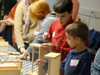 4-Hers and volunteers make wooden boxes during a workshop. Provided photo