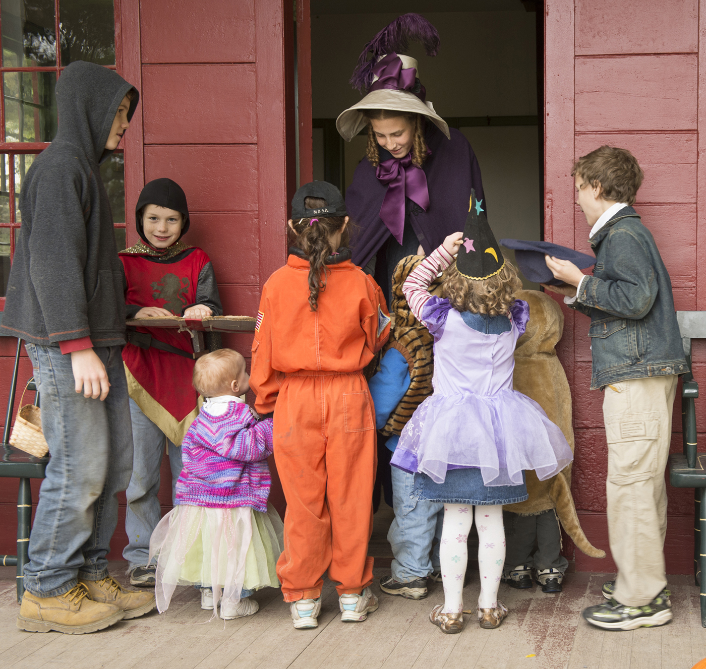 Trick-or-treaters are welcomed and treated to goodies during Genesee Country Village & Museum's Trick-or-Treating in the Village. Provided photo