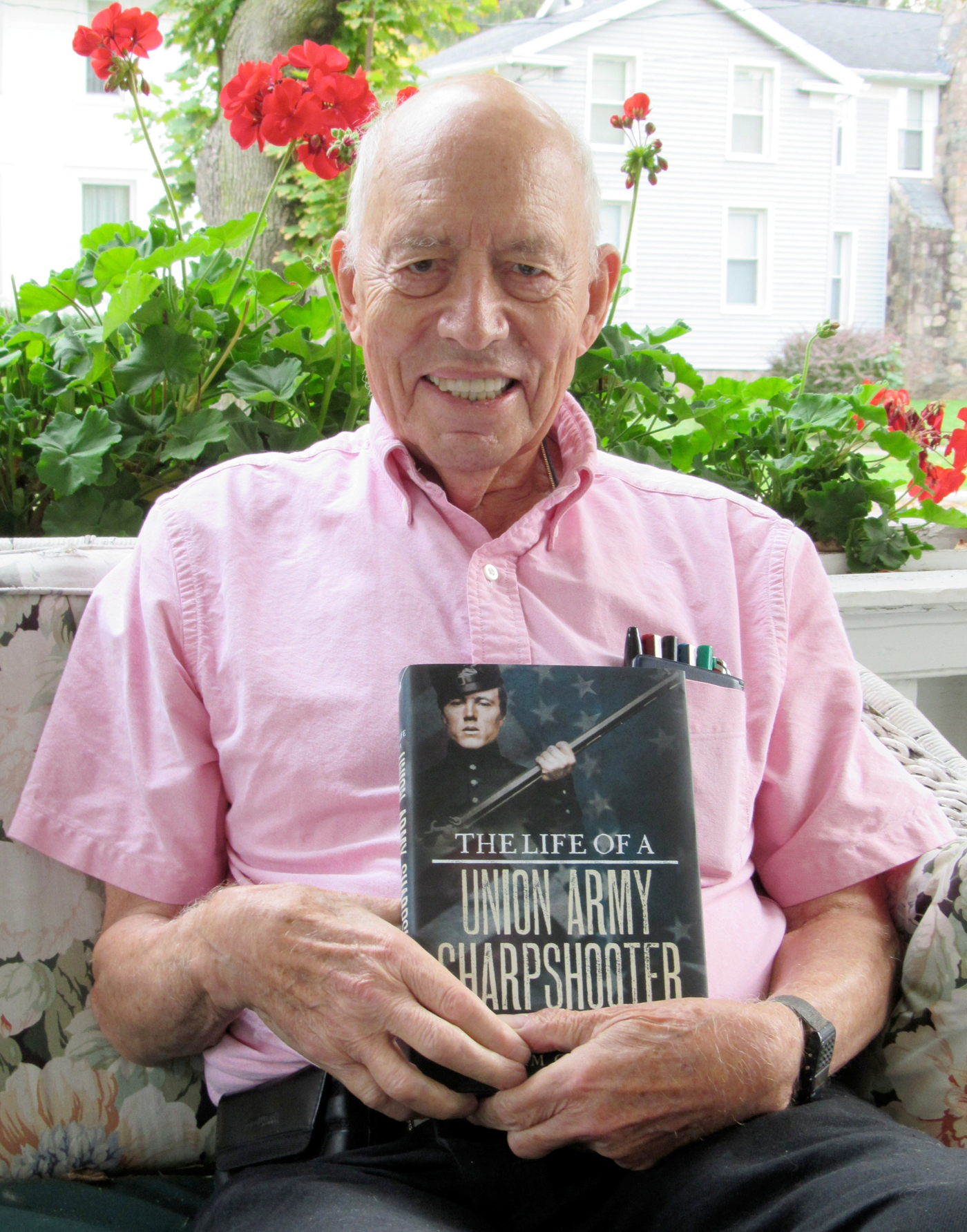 Bill Andrews poses on his porch with his newest book - The Life of a Union Army Sharpshooter: The Diaries and Letters of John T. Farnham. K. Gabalski photo