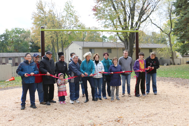 Village Board and Parks Committee members, College at Brockport students, families and neighbors join together for the park's ribbon cutting. Provided photo