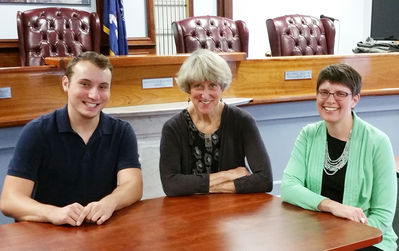 Justin Sullivan, Mayor Margay Blackman and Deputy Clerk/Treasurer Erica Linden meet weekly in the Brockport Village office building. Sullivan, a College at Brockport senior, recently started his internship working on media relations and social media for the Village. Photo by Dianne Hickerson