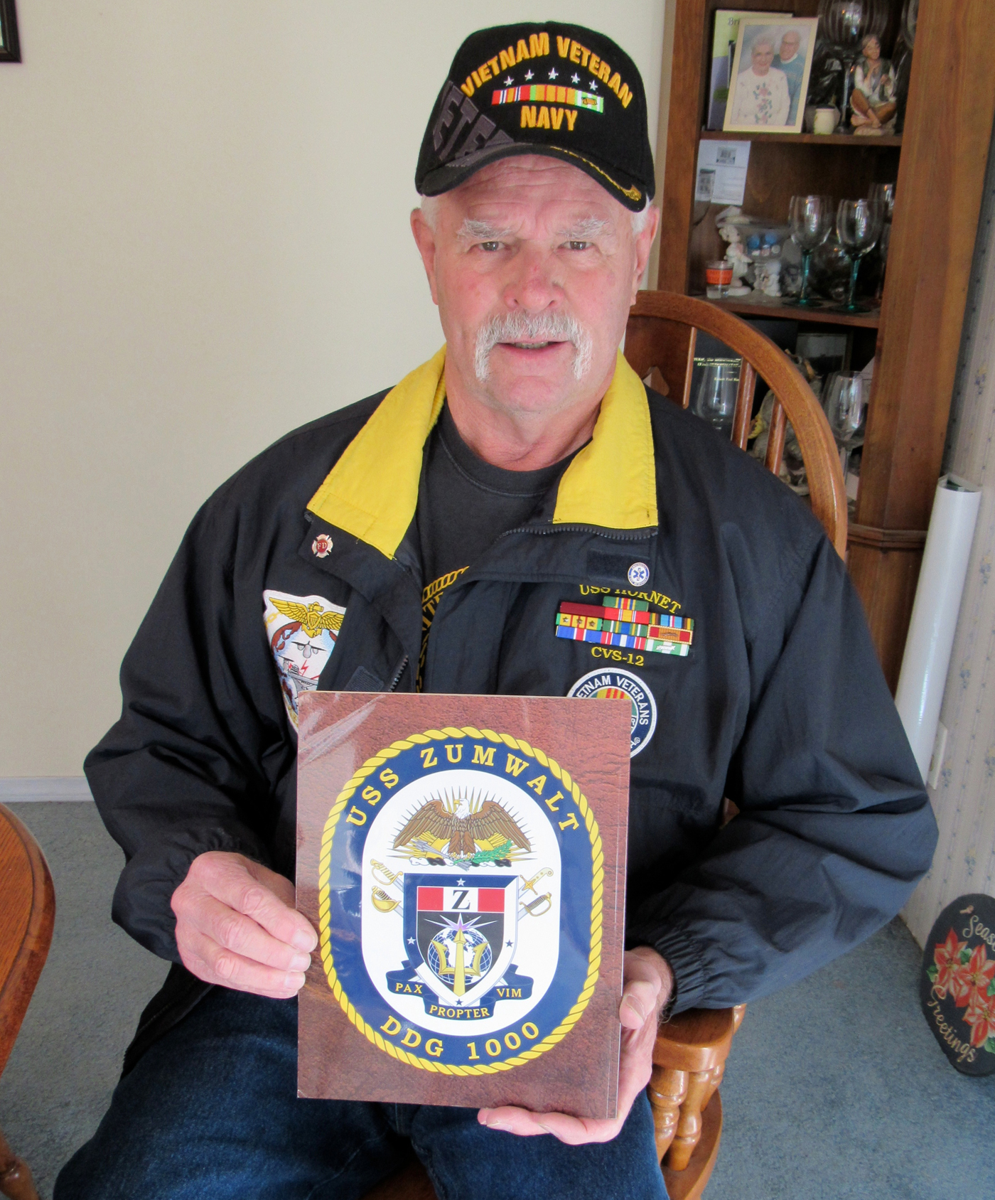 "Tom Hetherington holds a booklet he received while attending the commissioning of the new U.S. Navy Destroyer USS Zumwalt in Baltimore, Maryland. The motto of the state of the art ship is ""Pax Propter Vim"" - Peace Through Power. K. Gabalski photo."