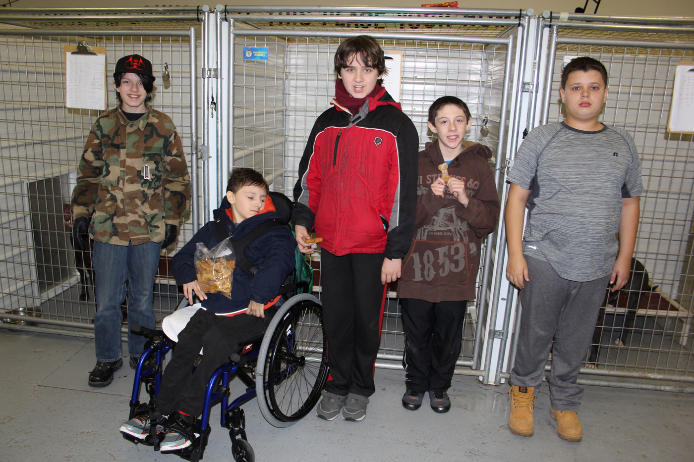 Left to right: Alexander Paul, Nicholas Hinkley, John Rounseville, Zachary Durney and Timothy Kemp deliver homemade dog treats to the Hamlin Dog Shelter. Provided photo