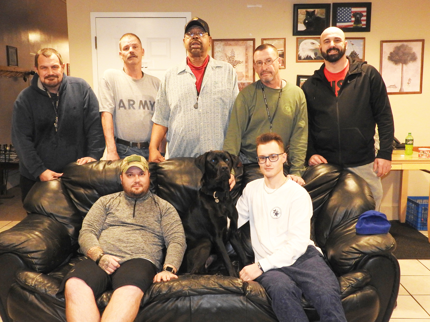 Veterans at Richards House, a home for male veterans run by the Veteran's Outreach Center. L-r back row: Ted, Tom, David, Joe and Jason; front row: Bruce, Hans (dog) and Austen. Photo by Karen Fien