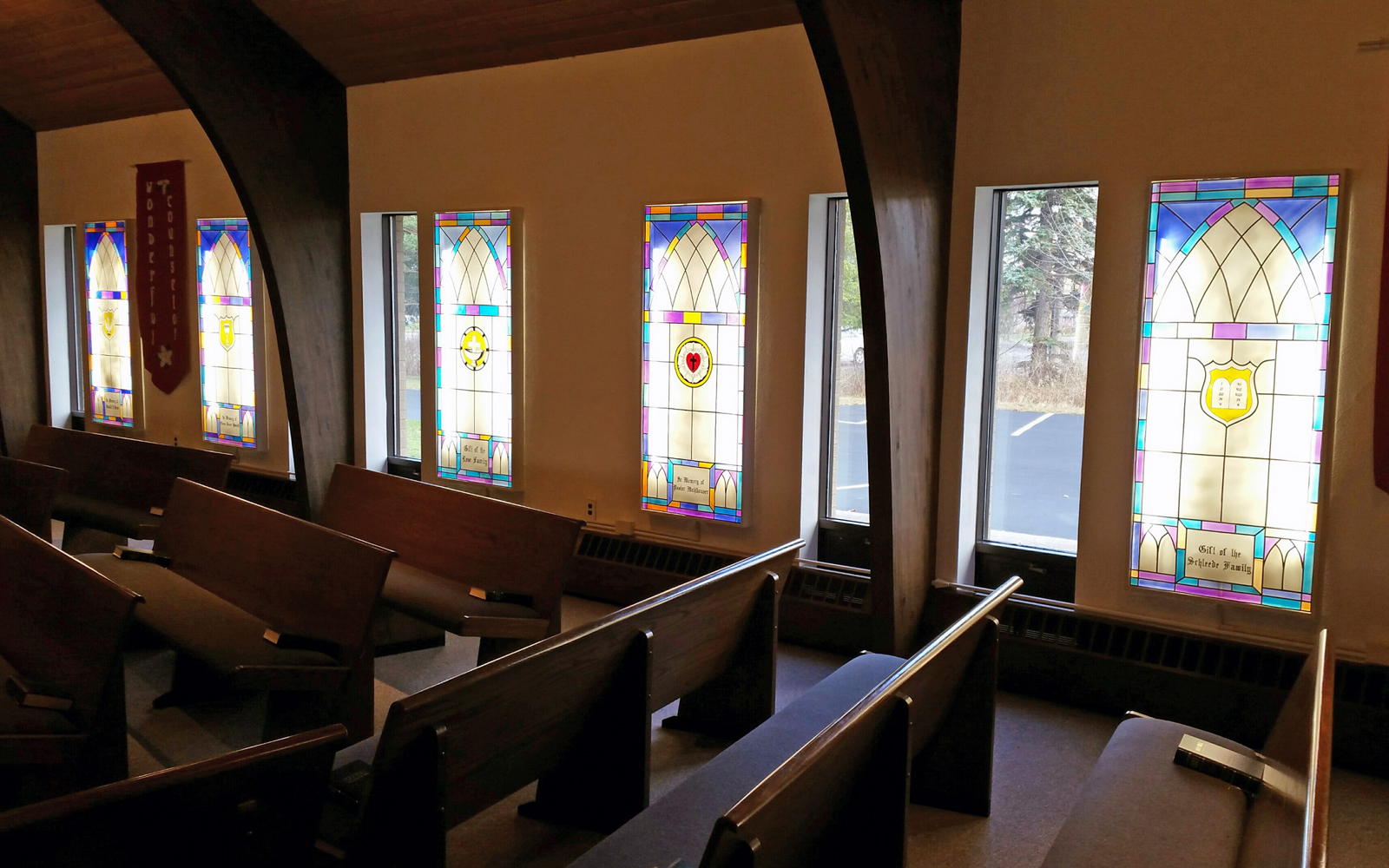 Concordia Lutheran Church in Brockport recently had the stained glass windows from the former church on Spring Street recreated with help from the late Marian Schleede Quackenbush. Her family's window can be seen to the far right. Photo by Grace Griffee