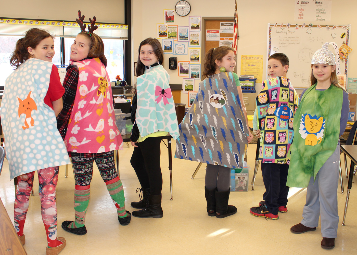 Shown l-r, Gianna DiPiazza, Julia DiPaola, Grace Ross, Libby Booth, Brady Graupman and Olivia Rist, all fifth graders at Northwood Elementary School in Hilton, model the capes they made for The Hero Project at Peyton Manning Children's Hospital for St. Vincent in Indianapolis. Provided photo