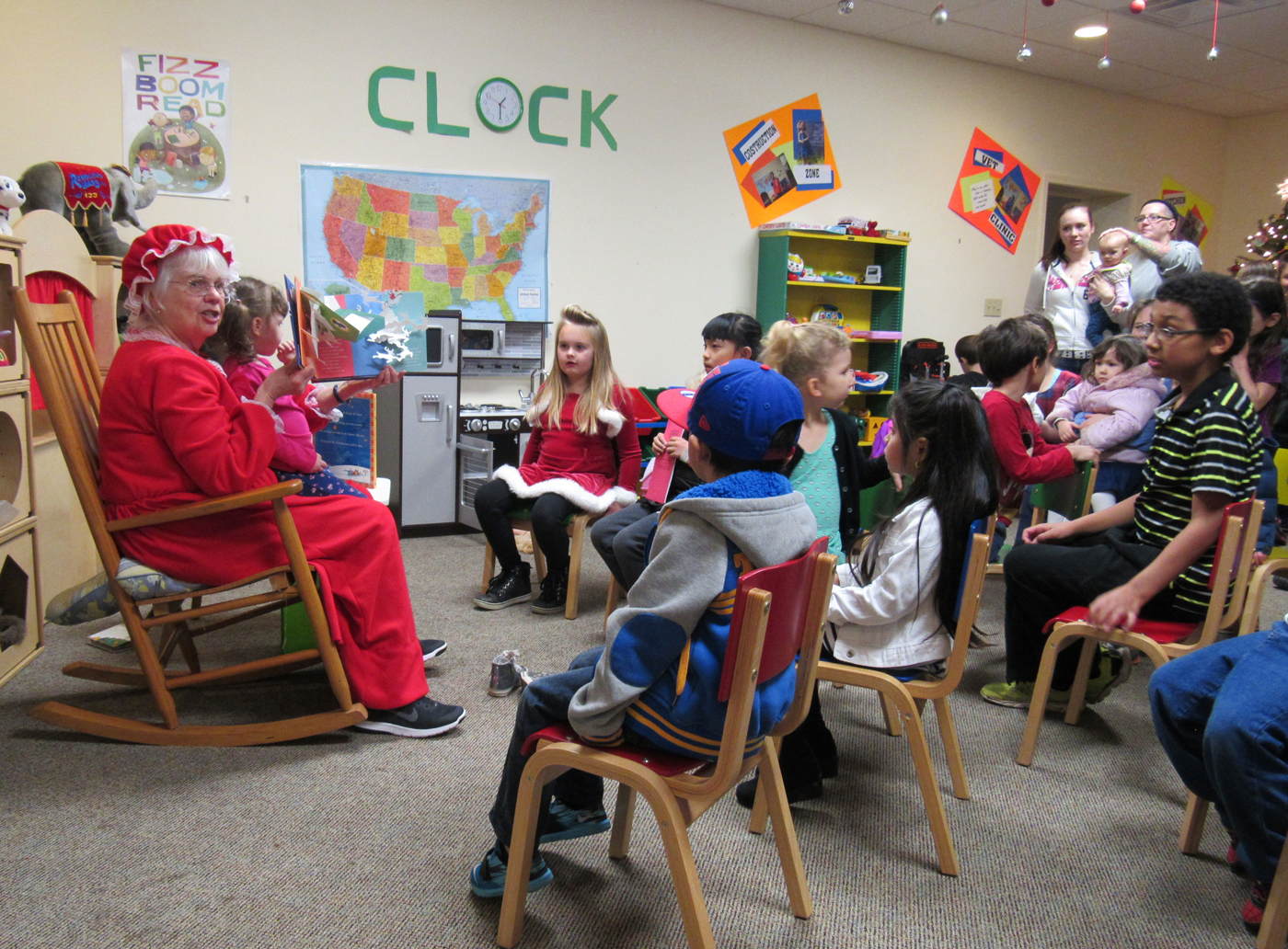 """Mrs. Claus"" keeps the young ones enthralled following a reading of ""T'was the Night Before Christmas"" at the Community Christmas Party at the Holley Community Free Library held December 2. K. Gabalski photo"