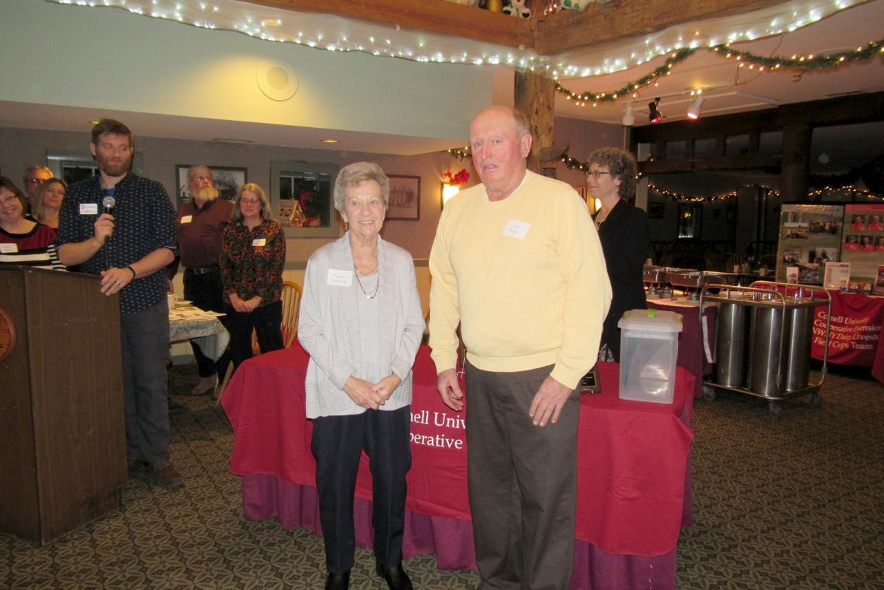 Pauline Lanning of Albion, left, was honored during the Orleans County Cornell Cooperative Extension Annual meeting in December for her 50 years as a 4-H Leader.  Standing on the right is Edward Neal, president of the Orleans County Cooperative Extension Board of Directors. K. Gabalski photo