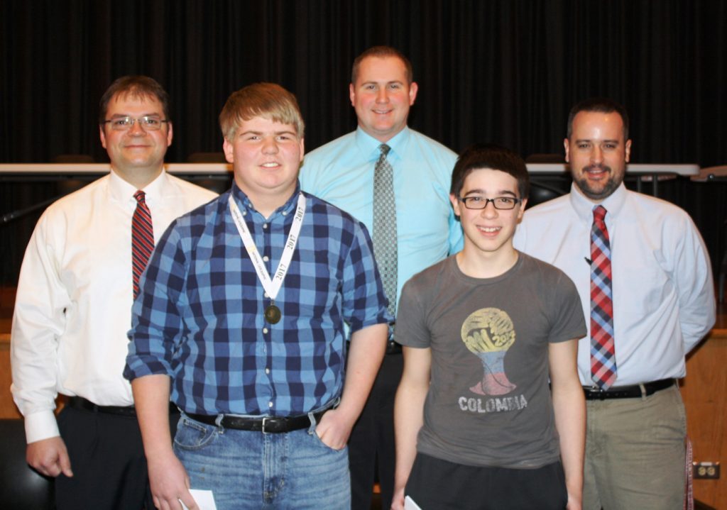 At the Jr./Sr. High School (l-r): Front - National Geographic Bee winner Andrew Parnapy and runner-up Richard Denson; back - social studies teachers Aaron Clark, Nick Muhlenkamp and Ken Gropp.