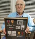 "Stewart Eugene ""Gene"" Walker, age 101, displays the medals he received for his service in the U.S. Army during WW II. G. Griffee photo."