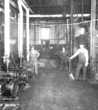 Men in the production room at the Heinz plant. Frank Pickett stands front left.