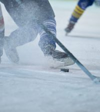 45310163 - ice hockey player in action kicking with stick