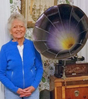 Sue Savard stands near the 1905 Edison phonograph restored to working condition by Tim Fabrizio.