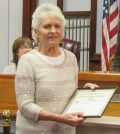 Sue Savard holds the Monika W. Andrews Creative Volunteer Leadership Award she received during the February 6 regular meeting of the Brockport Village Board. K. Gabalski photo.
