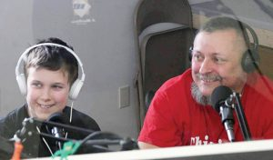 Rocco Stagnitto doing live radio broadcast with Rochester's youngest addiction advocate, his youngest son 11 year old Sebastian. Provided photo