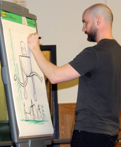 Author/Illustrator Peter Brown draws The Wild Robot for students at Quest Elementary School in Hilton. Provided photo