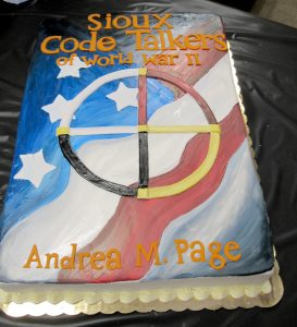 The cake (from Cake Co-op) at the book launch event was decorated to look like the cover of the book. The cover features a symbol which represents the four virtues of tribal life: serenity, bravery, fortitude and wisdom. K. Gabalski photo