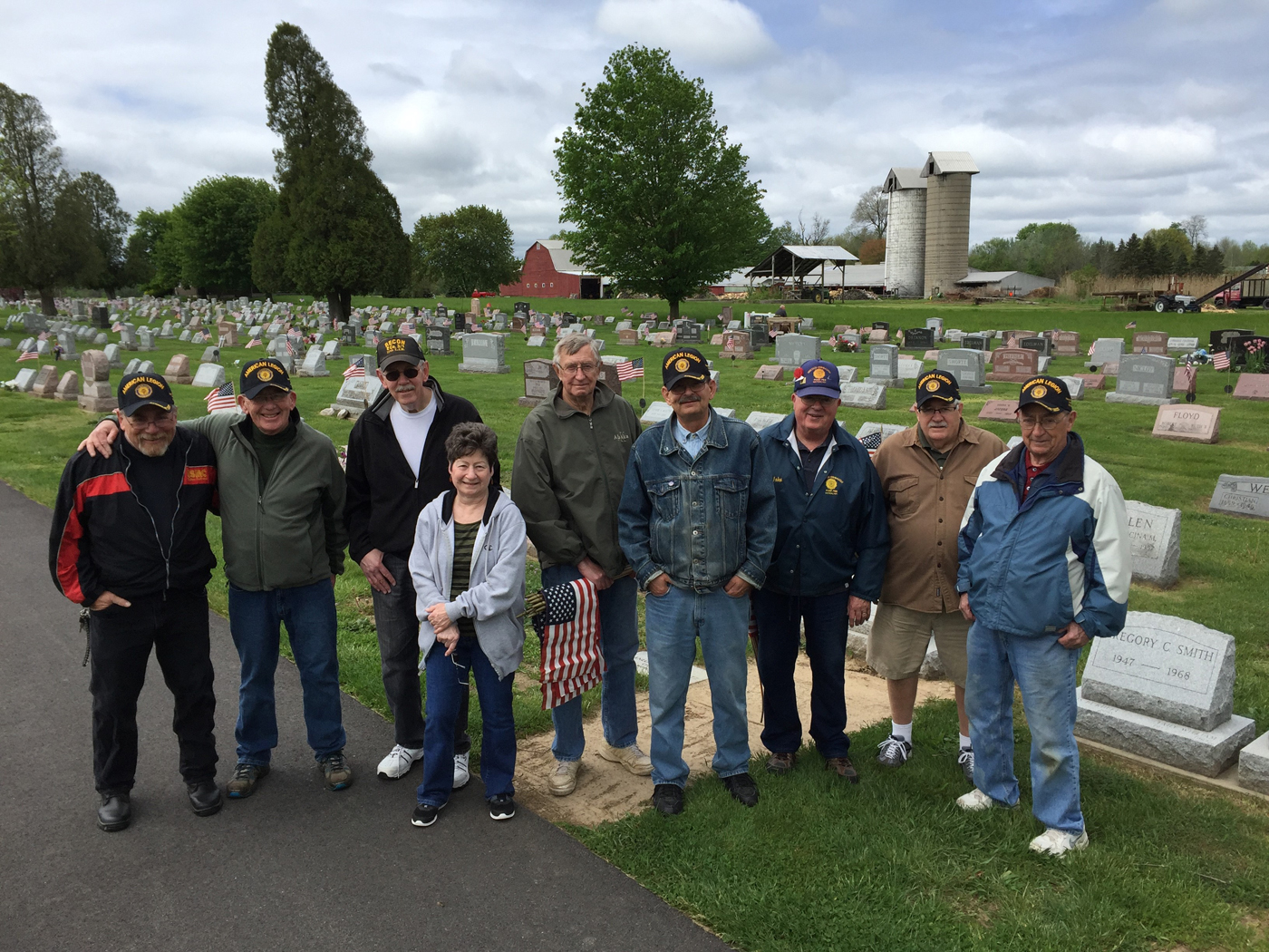 Members of Hiscock-Fishbaugh American Legion Post 788 and the Hilton-Parma Honor Guard place flags on Veterans' headstones at Parma-Union Cemetery May 19, 2016. Provided photo