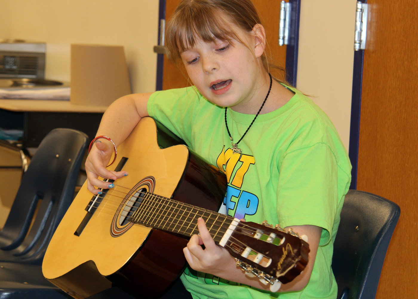 Juliana Charbonneau from Jen Robert's sixth grade class at Northwood Elementary School shows off her guitar skills in a coffeehouse style performance. Provided photo