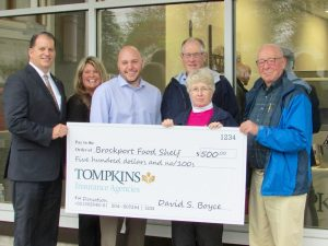Tompkins Insurance Agencies presents a check to the Brockport Ecumenical Food Shelf (l-r): David Boyce, President & CEO, Tompkins Insurance Agencies; Yvette Alexander, Sales Account Manager, Tompkins Insurance Agencies; Kyle Kurkowski, Assistant Vice President, Tompkins Insurance Agencies; Terry Marsham, Brockport Ecumenical Food Shelf; Linda Kruchten-Merring, Brockport Ecumenical Food Shelf; David Hale, Brockport Ecumenical Food Shelf. Provided photo