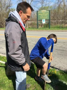 Teacher Buck Noble eyeing Jonathan Noble's spading technique at Arbor Day celebration. Provided photo