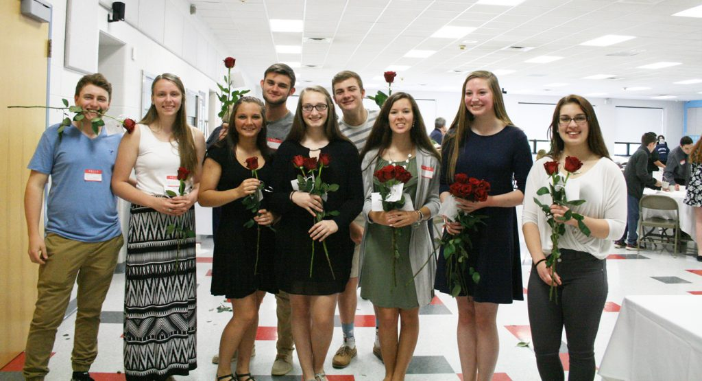 High school student council members were on rose patrol as they handed out roses to the breakfast attendees exiting the cafeteria. Provided photo
