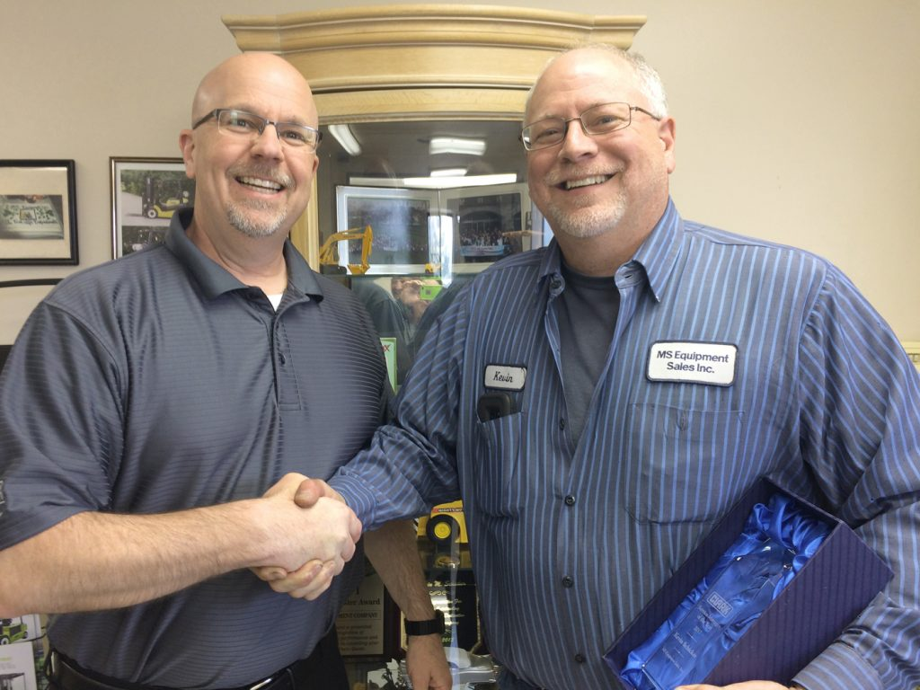 Andy Jurginson, Northeast Regional Coordinator of Clark Material Handling (left), presents Kevin Schicker with the Service Manager of the Year Award. Provided photo