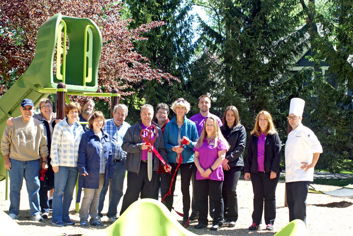 Brockport Wegmans manager, Frank Miceli, Mayor Margay Blackman, village officials, Wegmans staff, neighbors, and volunteers at the ribbon cutting for the Grand Opening of South Avenue Park playground. Provided photo