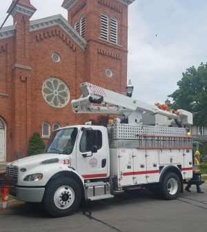 Spencerport Electric hybrid bucket truck.