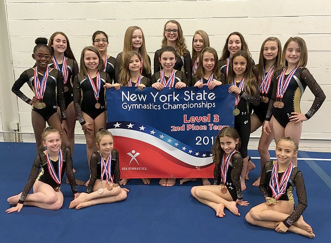 Bright Raven Level 3 Team with banner (l-r):  sitting - Isabella Curtis (Avon), Skylar Williamson (Chili), Abby D'Ambrosia (Brockort), Peyton Petrillo (Brockport); standing front row - Kennedi Gadsden (Greece), Grace Brady (Ogden), Hannah Prince (Greece), Ellie Arena (Fairport), Mary Cook (Brockport), Alexis Gerig (Greece), Cassie Barber (Greece); standing back row: - Baily Flynn (Churchville), Gabriela Barelli (Rochester), Rebecca Bready (Gates), Annika Ahlstrom (Gates), Gabrielle Lavallee (Gates), Trinity Sundine (North Chili) and Chloe Potts (Avon). Not in photo:  Heidi Tran and Kailey Tran. Provided photo