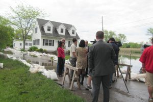 Continued flooding is evident along Sandy Harbor Drive in the Town of Hamlin, Tuesday, May 30. Hamlin Supervisor Eric Peters gave Monroe County Executive Cheryl Dinolfo and U.S. Congressman Chris Collins a tour of the area which included speaking with residents along the shoreline. Supervisor Peters said boating/fishing related businesses along the lake have not been able to open this year. K. Gabalski photo