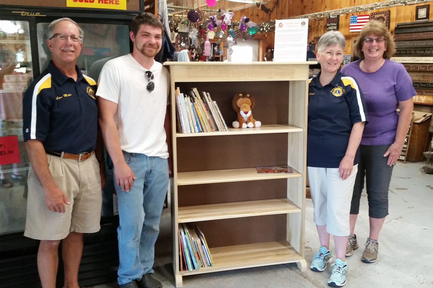 Standing with the new bookshelf (l to r): Incoming Lion President Michael Cusimano, Cabinetmaker Greg Meisenzahl, Lion Helen Unterborn and Lora Partyka. Provided photo