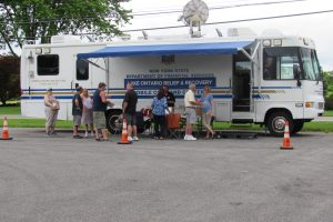 The NYS Department of Financial Services Mobil Command Center was sent by Governor Cuomo for the United Shoreline meeting in Hamlin. It was set up outside the Town Hall. Photo by Stephen Herbeck
