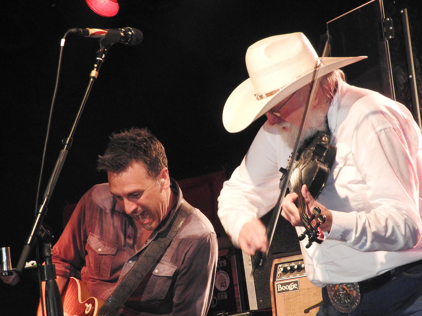 Chris Wormer (left) performs on the guitar next to Charlie Daniels. Photos by Karen Fien
