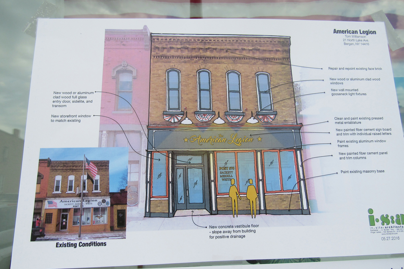 Buildings in the business district along Lake Avenue in Bergen had posters in the windows depicting what they could look like if Main Street Grant improvements are made. K. Gabalski photo
