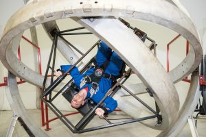 Hilton's Stephen Cudzilo, an eighth grade earth science teacher, experiences the multi-access trainer, which simulates the disorientation one would feel in a tumble spin during reentry into the Earth's atmosphere. Provided photo