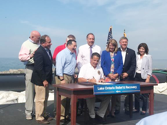 Assemblyman Steve Hawley (R,C,I-Batavia), second from the left, joins Governor Cuomo and legislators in Irondequoit to sign a $45 million Lake Ontario relief bill into law. Provided photo