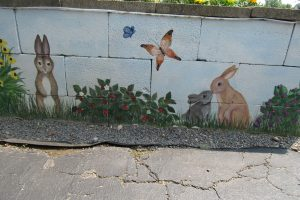 Bunnies and butterflies on another wall of the garden bed. K. Gabalski photo