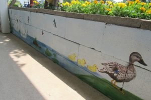 The side of the mural facing the house includes a pond scene with ducks and swans. K. Gabalski photo