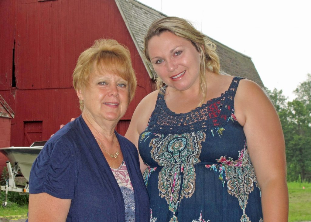 Rotary president Eileen Whitney (left) poses with Jenny Brongo, owner of Homesteads for Hope