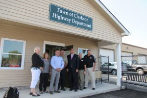 Clarkson Town Board members join New York State Senator Joseph Robach and Clarkson Highway Superintendent Bob Viscardi outside the newly completed offices at the Highway Department Garage on Route 19.  (L-R):  Councilperson Jackie Smith, Councilperson Christa Filipowicz, Supervisor Paul Kimball, Highway Superintendent Bob Viscardi, Senator Robach, Councilperson Allan Hoy and Councilperson Patrick Didas. K. Gabalski photo