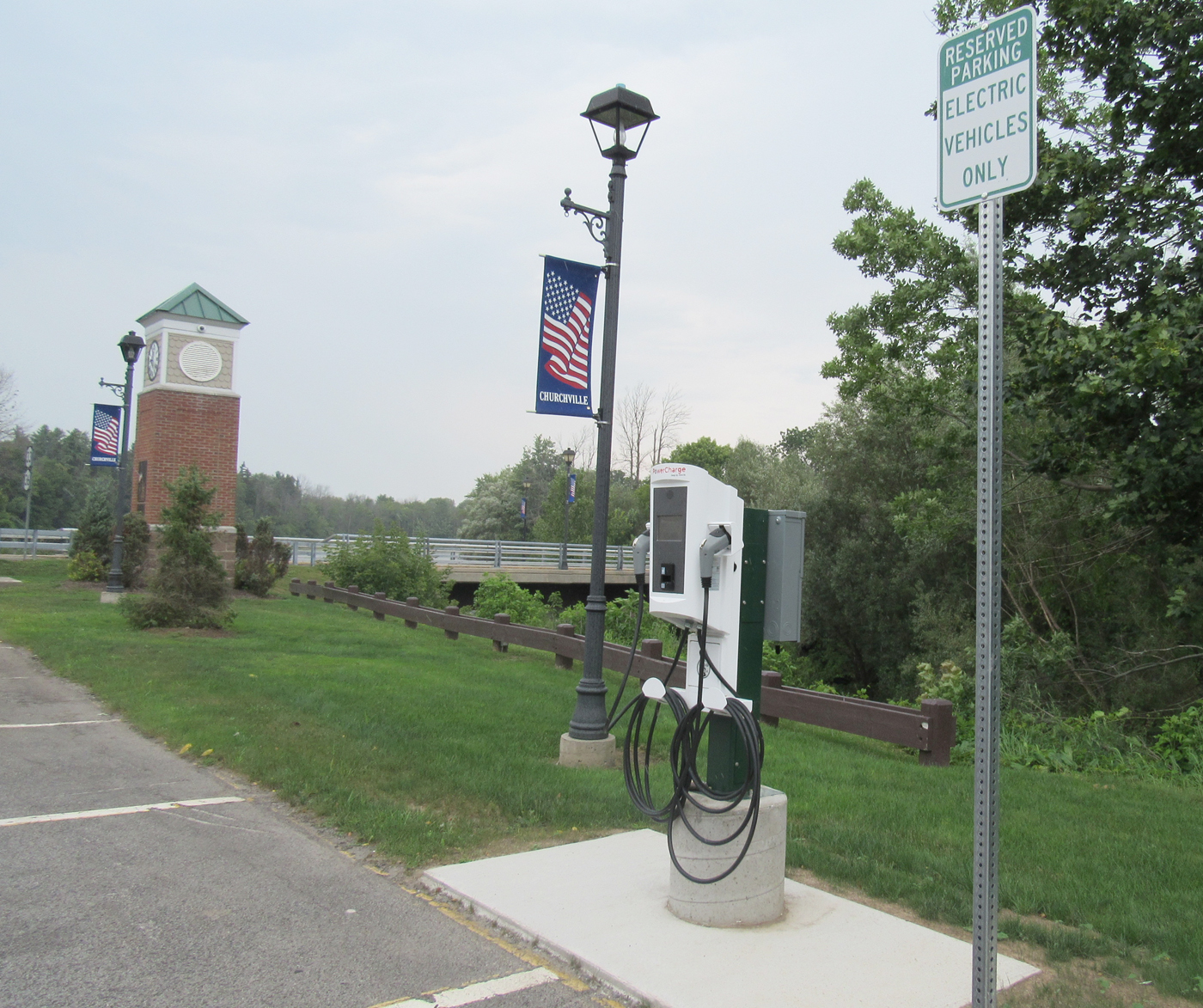 The new electric vehicle charging station in the Churchville municipal parking lot is one of four high impact clean energy actions village leaders took to obtain the Clean Energy Community designation. K. Gabalski photo