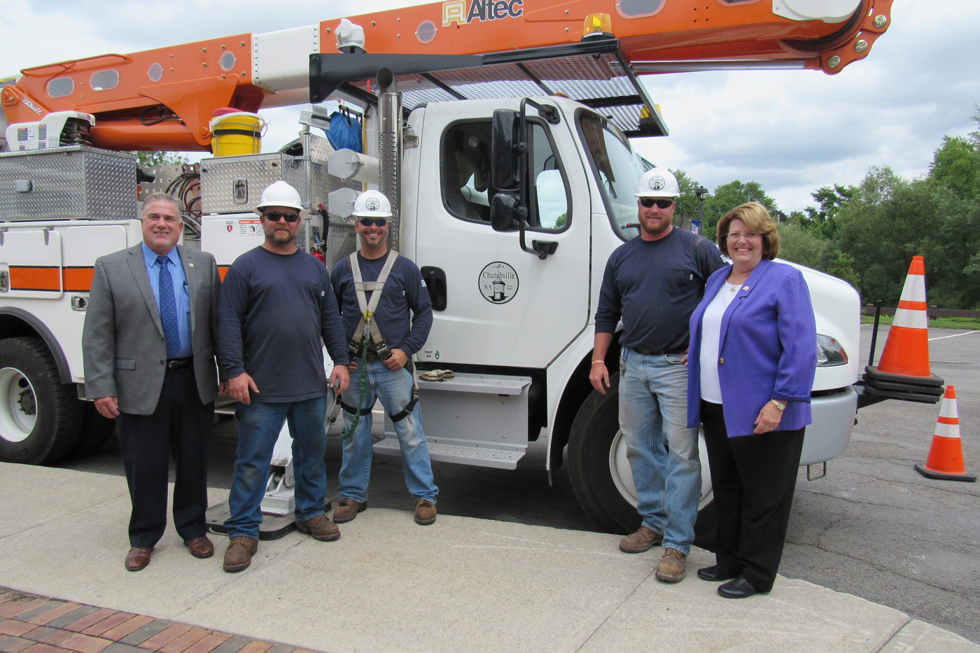 Churchville Municipal Electric linemen pose with local leaders outside the Village Offices in Churchville (l-r): Monroe County Legislator Steve Brew, Ken Yoffredo, Ed Rivers, Adam Hettis and Mayor Nancy Steedman. K. Gabalski photo