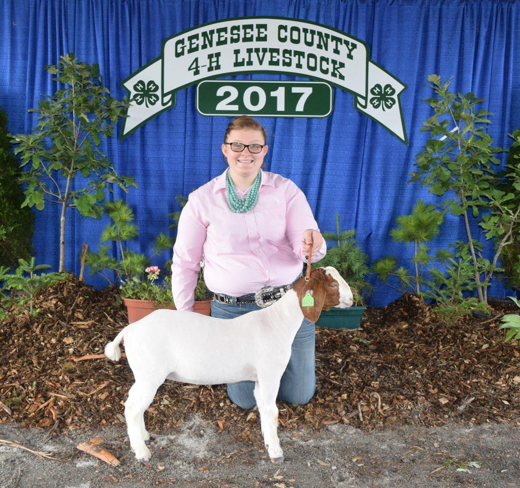 Melissa Keller with her Champion Market Goat.