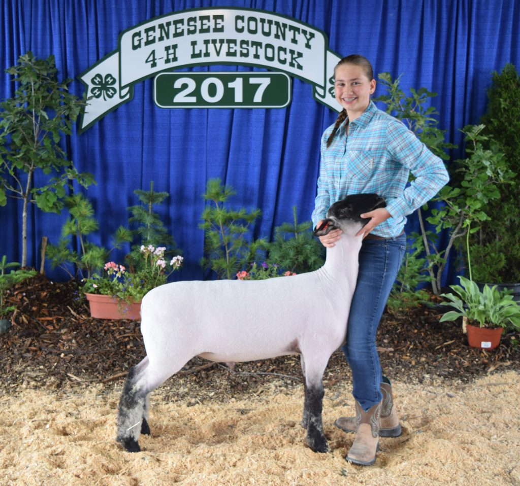 Madelynn Pimm with her Champion Market Lamb.
