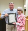 "Sweden Town Councilperson Robert Muesebeck presents a resolution Memorializing the late Wayne ""Jack"" Mazzarella to Christine Mazzarella, Jack's wife, during the Sweden Town Board meeting August 29. K. Gabalski photo"