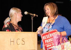 Heidi Barrett (left), teaching assistant, presents Beth Eichas, teacher's aide at Hilton High School, with the Hilton Central School District School-Related Professional of the Year Award. Provided photo